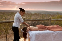 A guest enjoys a relaxing massage at The Elephant Camp.
